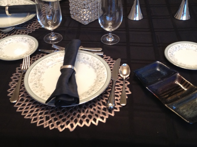Placesetting with slumped glass condiment serving dish
