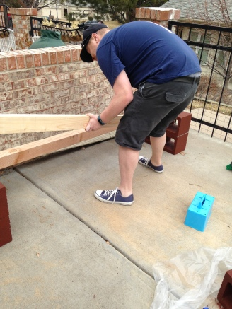 Step 4: insert 4x4's into painted cinder blocks